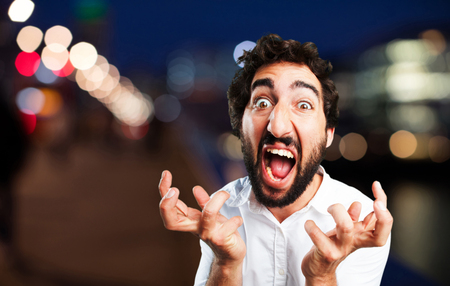 young funny man angry pose Stock Photo