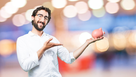 young funny man with piggy bank