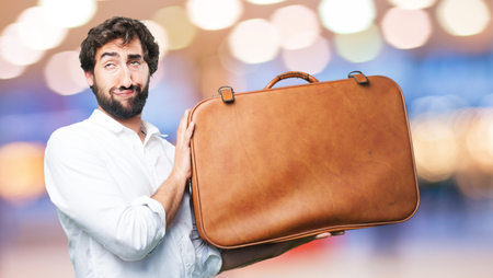 young funny man with travel case Stock Photo