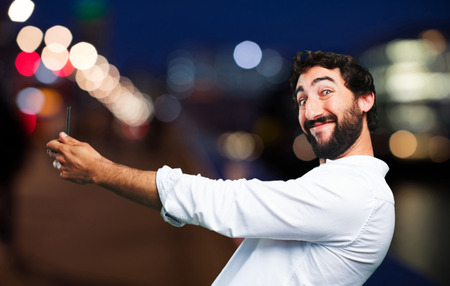 young funny man with mobile phone Stock Photo