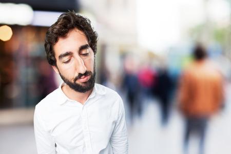 young funny man boring pose. sad expression