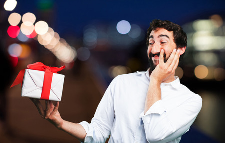 celebration smiley: young funny man with a gift