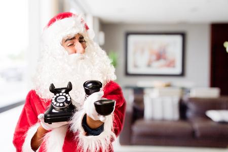 newyear: santa claus with vintage phone