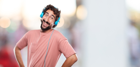 young bearded man Laughing out loud with head tilted backwards and happy, cheerful expression Фото со стока