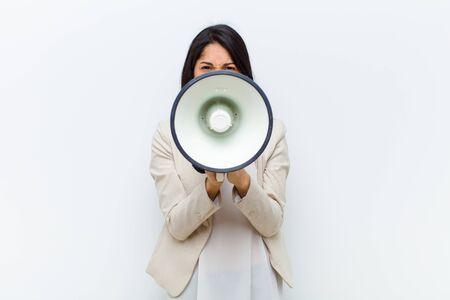 young hispanic pretty woman with a megaphone Standard-Bild