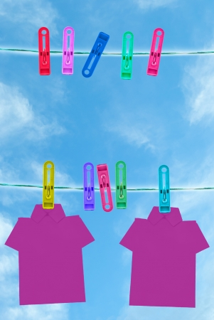 whiff: colorful of T shirt on the clothes line in blue sky day