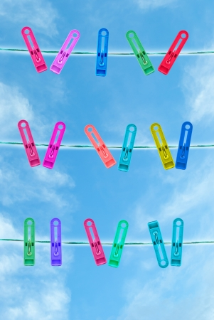 whiff: colorful of clothespin on the clothes line in blue sky day
