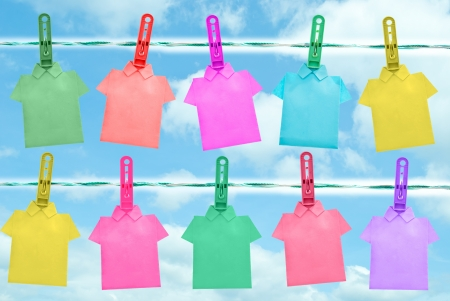 colorful of T shirt on the clothes line in blue sky day