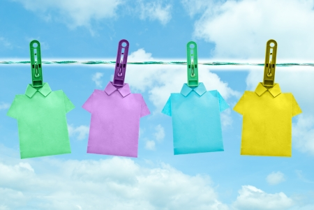 colorful of T shirt on the clothes line in blue sky day photo