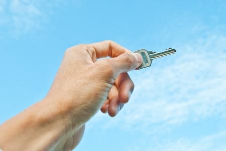 key go to success on blue sky background photo