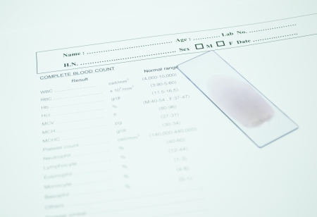 blood smear on paper report result in laboratory Stock Photo - 14474927