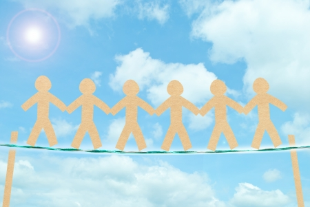 paper people in blue sky background