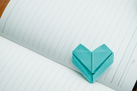 colum: paper heart on note book for background or texture