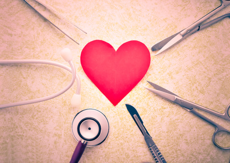 medical  equipment set and red paper heart
