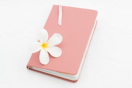 plumeria flower: Leather diary with pink plumeria flower white isolate.