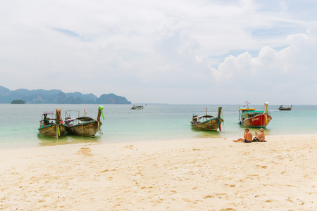 KRABI, THAILAND - MAY 6 :  holidaymakers relaxing on the beach on May 6, 2016 in Poda Island, Krabi, Thailand. Publikacyjne