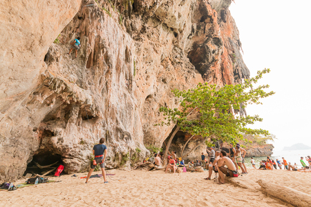 railay: RAILAY, THAILAND - May 4, 2016: Rock climbers climbing the wall on Railay beach, one of the most popular rock climbing locations in Asia.