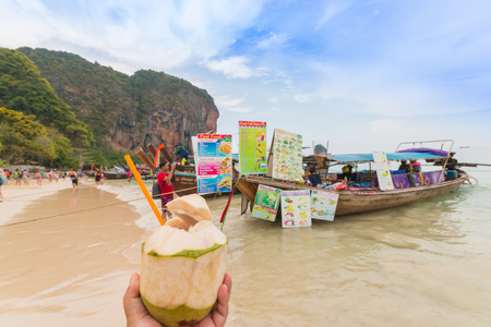 phuket food: PRANANG BEACH, CRABI PROVINCE, THAILAND - MAY 04, 2016: Traditional thai long tail boats with food and drinks for tourists on Pranang beach at Railay , Krabi province, Thailand