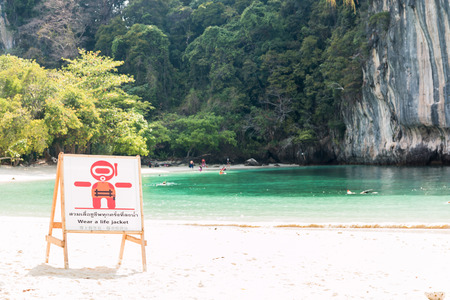 life jacket: Warning labels, put a life jacket on a beach in Thailand.