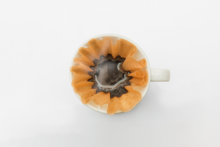 papel filtro: Cup of coffee filter paper Foto de archivo