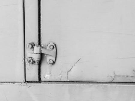 Old doors close-up, black and white. Lizenzfreie Bilder
