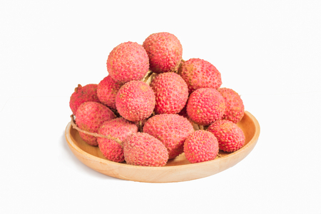 Lychee fruit in a bowl on a white background.