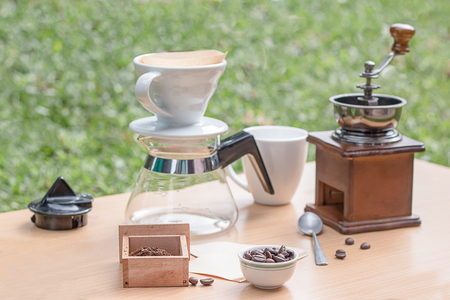 Drip coffee maker on a table in the garden.