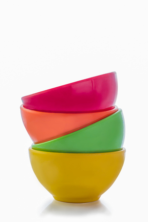 Multi color cup are stacked on white background.isolated.