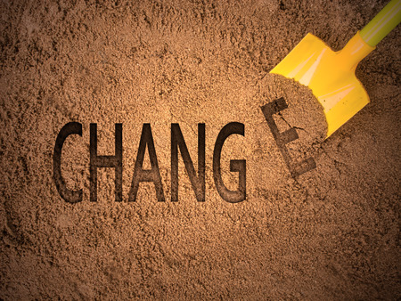 Change concept by digging sand Stock Photo