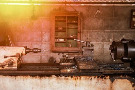 old workshop Lathe and sunrise. Lizenzfreie Bilder