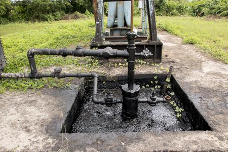 oil pump in rice field in the countryside. Lizenzfreie Bilder