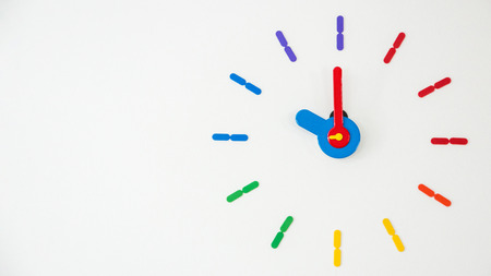Wall clock in multiple colors on a white background.