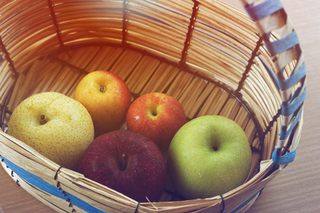 sunrise with variety apples in the basket.