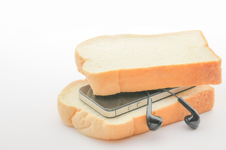 concept eat bread with a smartphone on white background. Banco de Imagens - 111071990