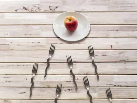 concept apple and  forks on wooden wall background.