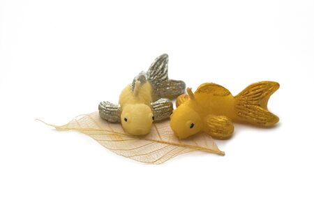 Two goldfish scented candle on white background. Stock fotó