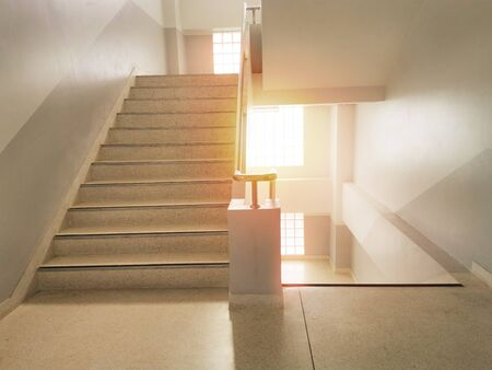 Building stairs and sun rise In the building.