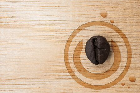 concept switch coffee bean and water drop on wood table.