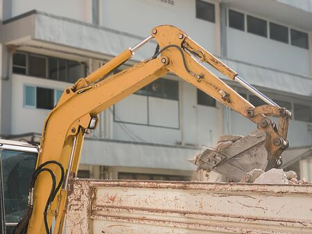 Bulldozer Removes the debris from demolition on the construction site Stock fotó