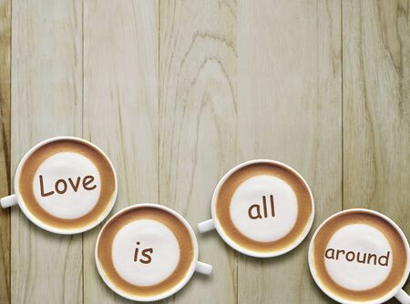 Concepcion message Love is All Around on the latte coffee. Stock fotó