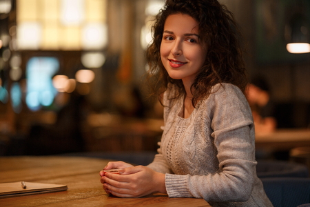 Woman with cup of coffee in cafe