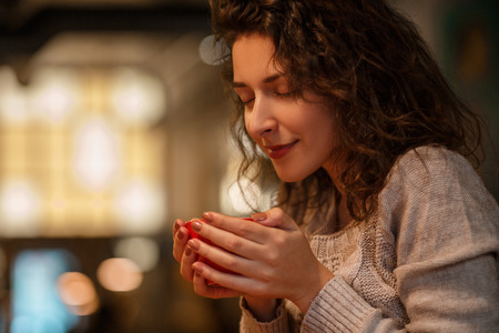 woman sniffing aroma coffee from cup Stock Photo