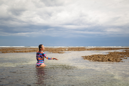Sexy woman posing at ocean beach