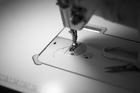 Closeup sewing machine needle Tailor industry Foto de archivo