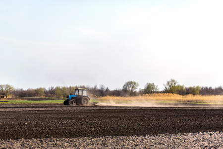 a tractor plows a field for sowing crops.