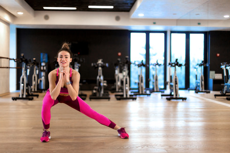 Young woman in sportwear sport exercise in gym. Fitness and wellness lifestyle concept.