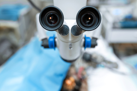 Operating microscope close-up. Sterile operating room in a veterinary clinic. Preparing for the operation of the dog. The ophthalmologist operates on the eye of the dog. Endoscopic surgery of the eyes Фото со стока