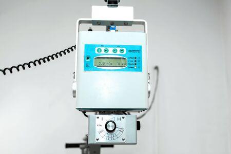 Old veterinary x-ray machine closeup at a veterinary hospital.