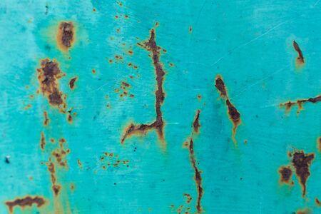 Rust appears through paint on metal doors.