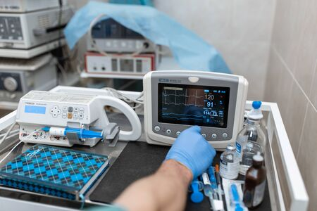 Heart rate monitor in hospital theater. Medical vital signs monitor instrument in a hospital on anesthesia surgery monitor.  ECG Patient Monitor. medical electronics.